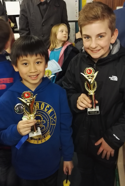 Toby and Jack with their trophies